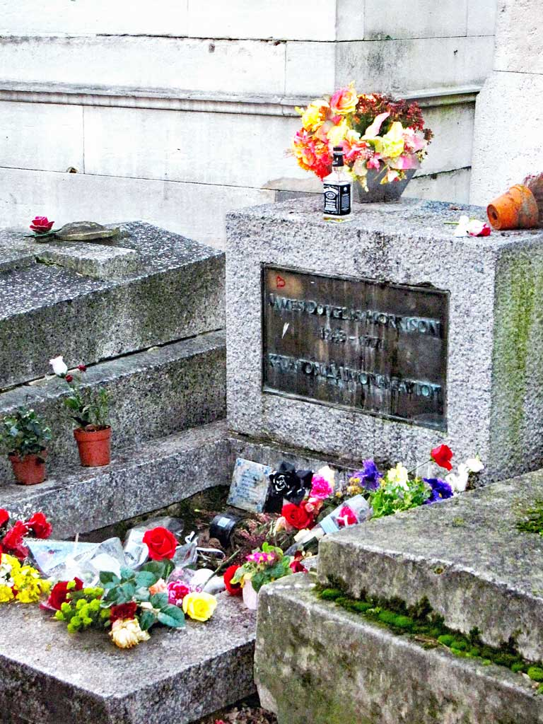 Jim Morrison's grave in Paris - this was what it looked like in late 2013, it has over the years been vandalized and redone many ties.