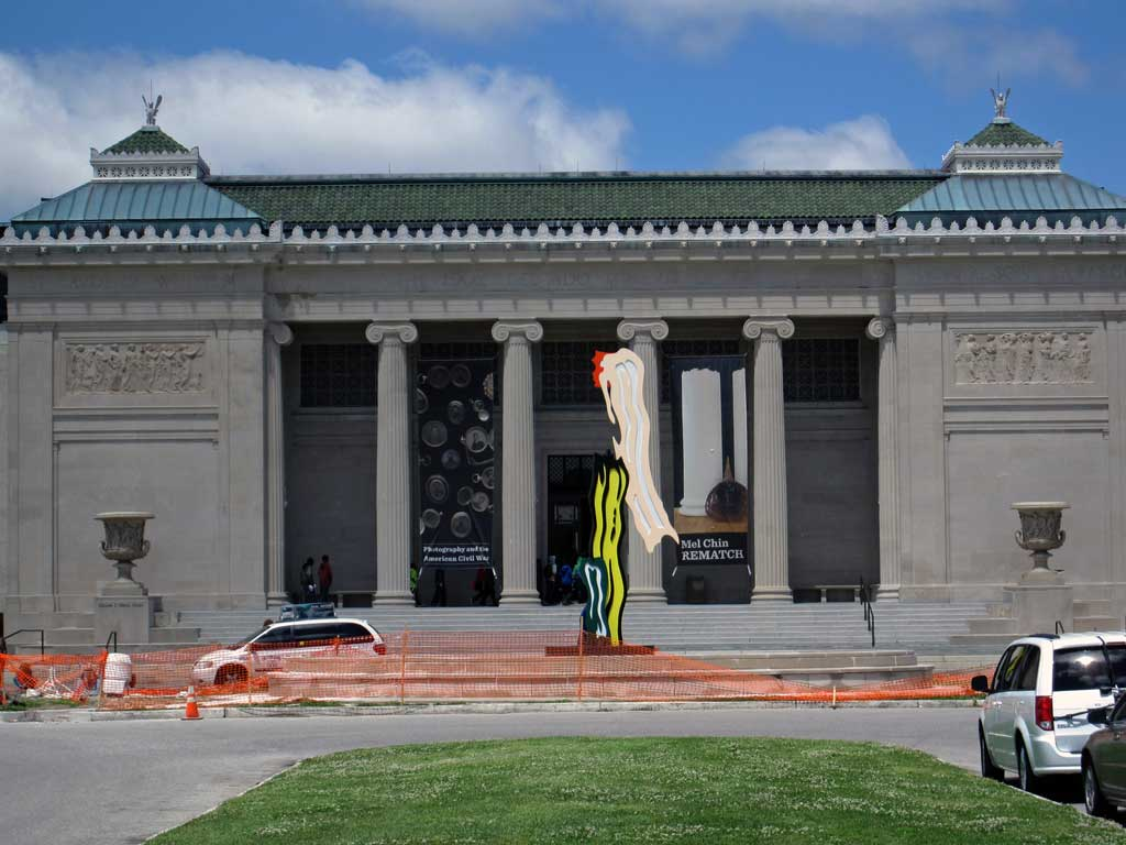 Noma with a Roy Lichtenstein sculpture in the fountain in front of the building.
