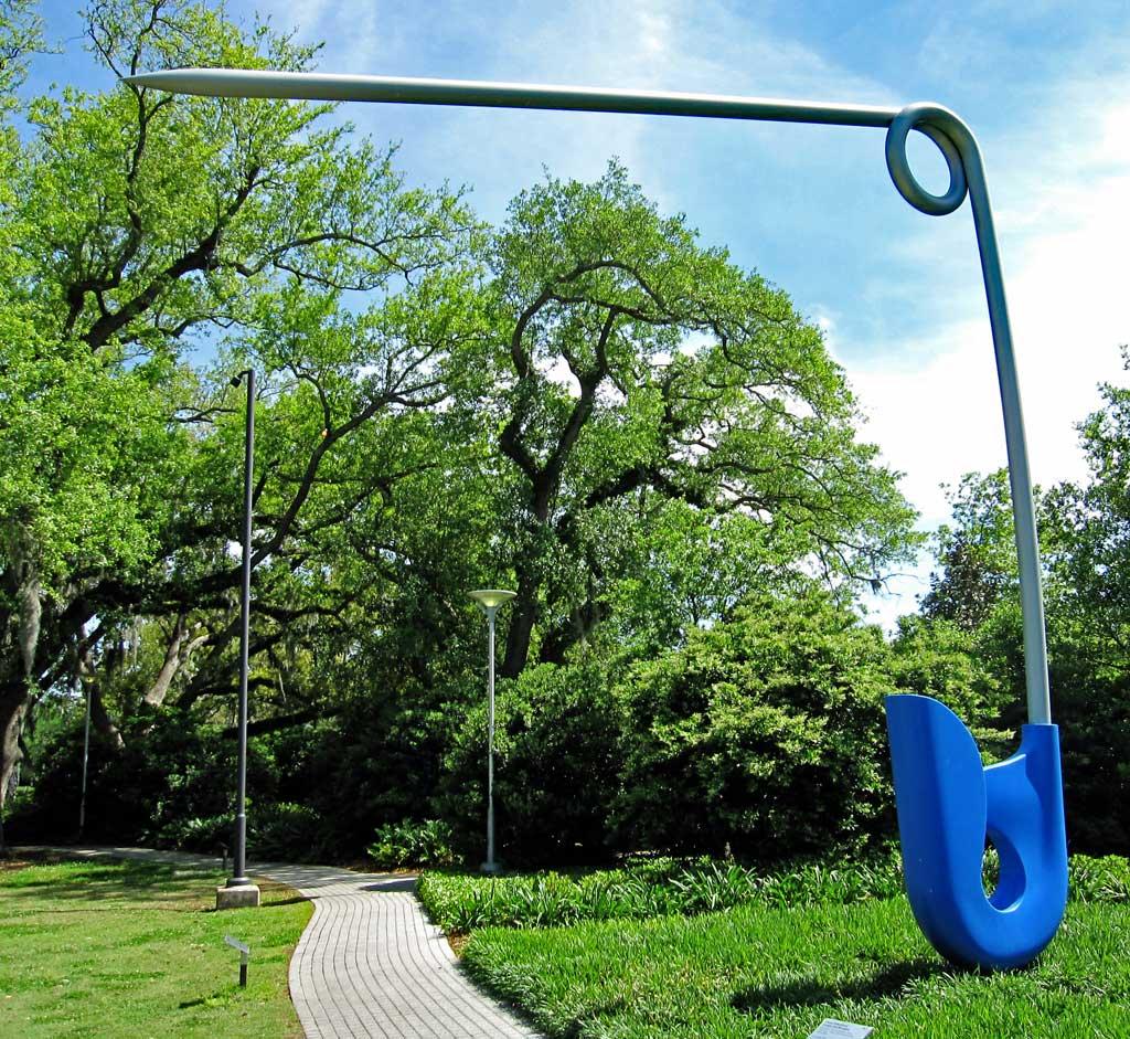 """Claes Oldenburg and Coosje Van Bruggen """"Corridor Pin"""" piece in the garden."""
