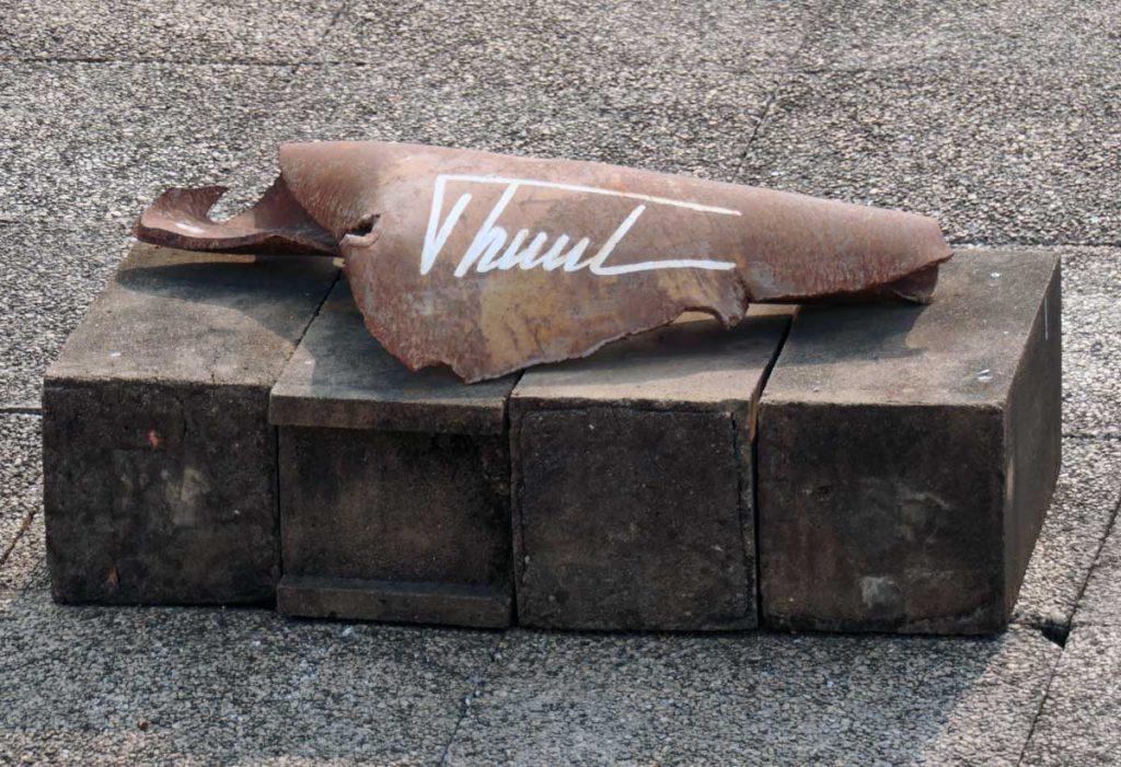 Closeup of the autographed shrapnel.